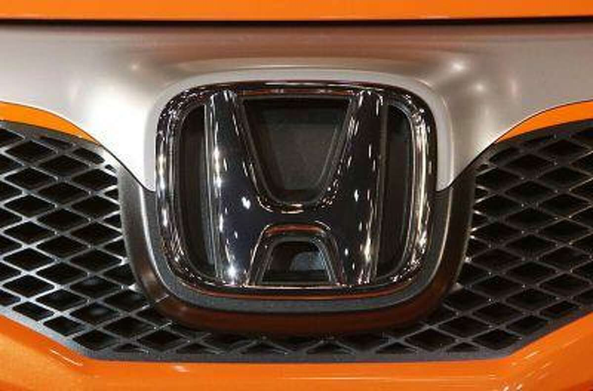 Honda Motor Co. Ltd's logo is seen on the company's Sports Modulo Fit concept vehicle displayed at Tokyo Auto Salon 2009 at Makuhari Messe in Chiba, east of Tokyo.