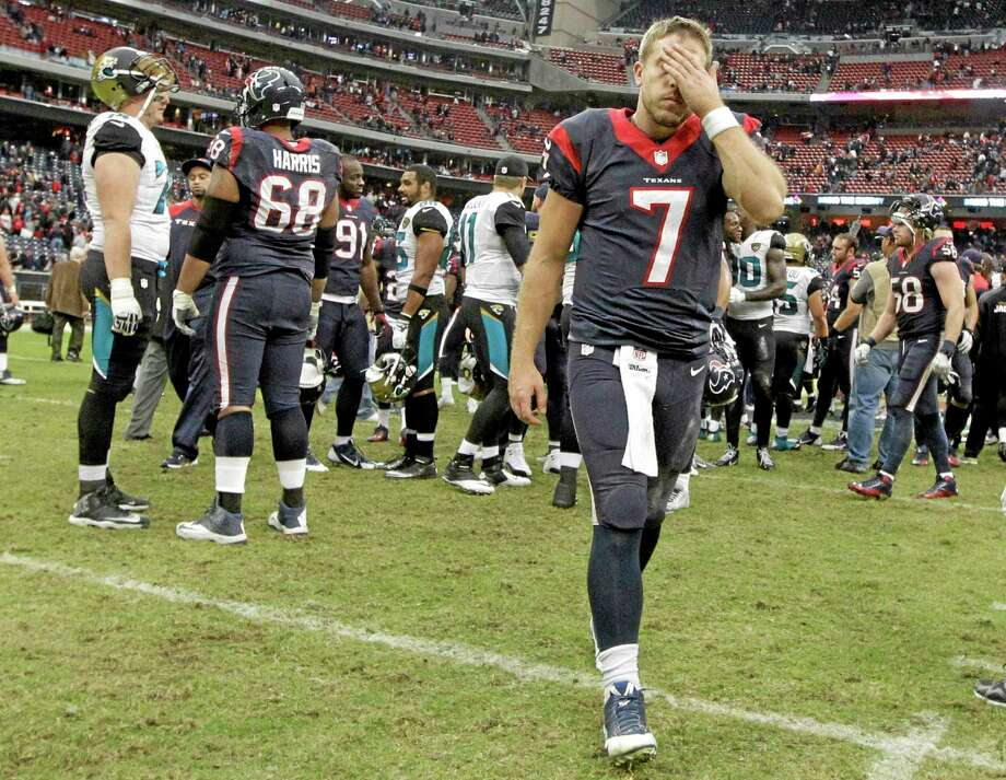 Texans quarterback Case Keenum (7) leaves the field after last Sunday's 13-6 loss to the Jacksonville Jaguars in Houston. Photo: Patric Schneider — The Associated Press  / FR170473