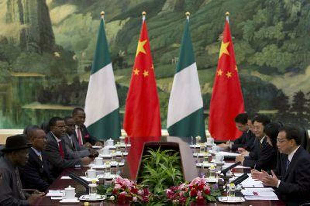Chinese Premier Li Keqiang talks during his meeting with Nigerian President Goodluck Jonathan at the Great Hall of the People on July 11, 2013 in Beijing, China.