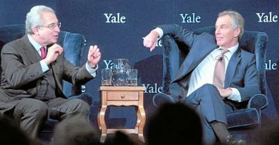 Former President of Mexico Ernesto Zedillo (left) and former British Prime Minister Tony Blair (right) participate in the forum, Global Crises: The Way Forward, at Yale University's Battell Chapel in New Haven on 12/3/2012. Photo by Arnold Gold/New Haven Register