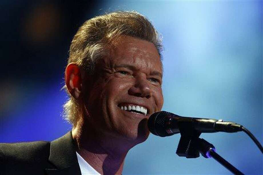 FILE - In this June 7, 2013 file photo, Randy Travis performs on day 2 of the 2013 CMA Music festival at the LP Field in Nashville, Tenn. Publicist Kirt Webster on Wednesday night, July 10, 2013 said that the 54-year-old Travis is in surgery after suffering a stroke while he was being treated for congestive heart failure because of a viral illness. (Photo by Wade Payne/Invision/AP, File) Photo: Wade Payne/Invision/AP / Invision
