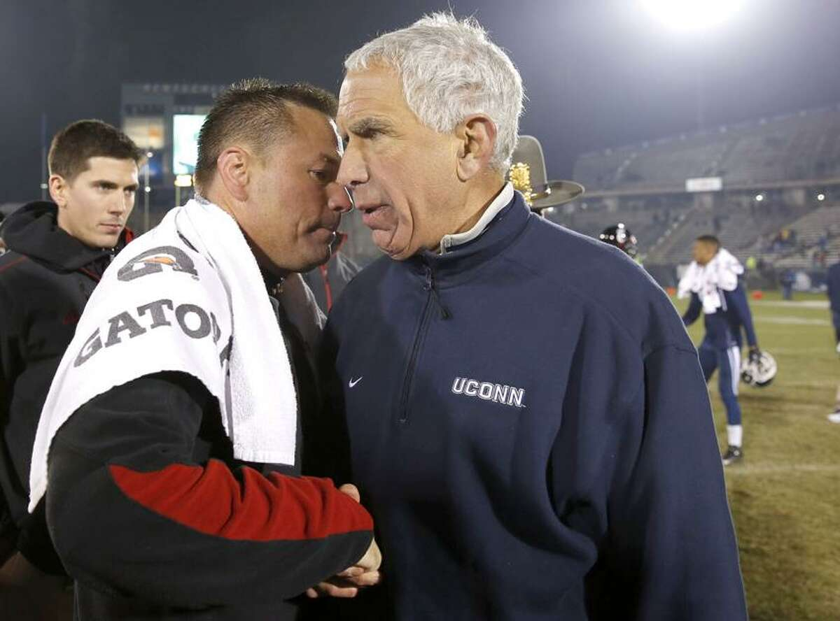 Dec 1, 2012; East Hartford, CT, USA; Connecticut Huskies head coach Paul Pasqualoni and Cincinnati Bearcats head coach Butch Jones meet on the field after the game at Rentschler Field. The Bearcats defeated UConn, 34-17. Mandatory Credit: David Butler II-US PRESSWIRE