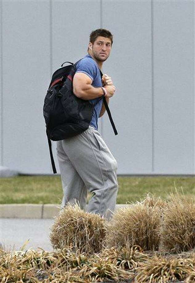 In this Monday, April 15, 2013 file photo, New York Jets quarterback Tim Tebow arrives on the first day of NFL football offseason workouts at the Jets practice facility in Florham Park, N.J. The New York Jets say, Monday, April 29, 2013, they have waived Tim Tebow. (AP Photo/Mel Evans, File) Photo: AP / AP