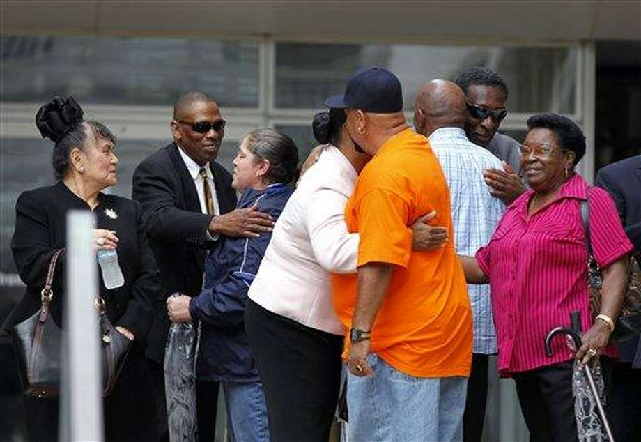 Family members and supporters of victims who were killed by New Orleans police hug each other outside Federal Court after sentences were handed out in the case Wednesday in New Orleans. Five former New Orleans police officers were sentenced to prison terms ranging from six to 65 years for their roles in deadly shootings of unarmed residents in the chaotic days after Hurricane Katrina.  Associated Press Photo: AP / AP