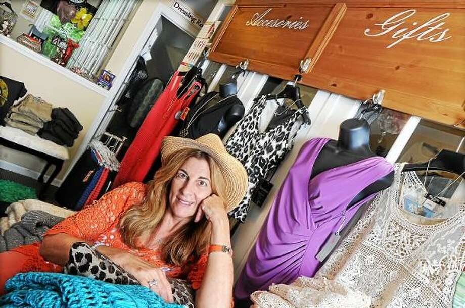 Catherine Avalone - The Middletown Press Diane Magnano, owner of 2 Di 4 Boutique at 573 Newfield Street in Middletown located on the second floor of Emanuel's Hair Salon. / TheMiddletownPress