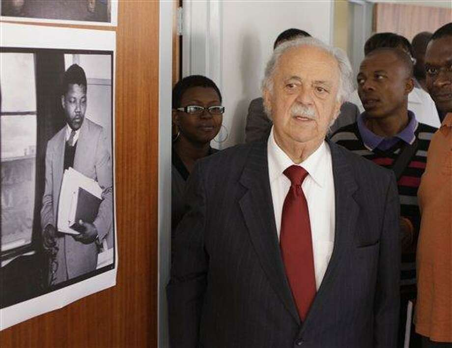 FILE - In this Wednesday May 4, 2011, file photo, Advocate George Bizos tours the building where Nelson Mandela and Oliver Tambo had a historic law office in Johannesburg. Bizos, a member of the legal team that defended Mandela and others at the Rivonia trial, said Machel invited him to see Mandela in the hospital last month. But the visit was canceled when the health of his old friend deteriorated. (AP Photo/Denis Farrell, File) Photo: AP / AP