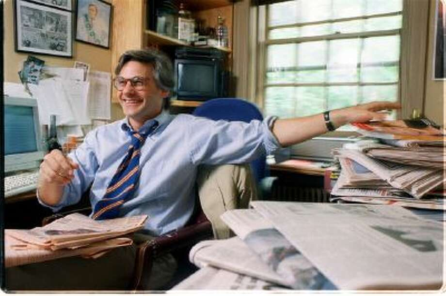 "In this Sept. 10, 2007, photo, New York Observer editor Peter Kaplan sits at his desk in New York City. Kaplan, who hired a then-unknown Candace Bushnell to write a column called ""Sex and the City,"" died Friday, Nov. 30, 2013, in New York, of cancer, said his wife, Lisa Chase. He was 59."