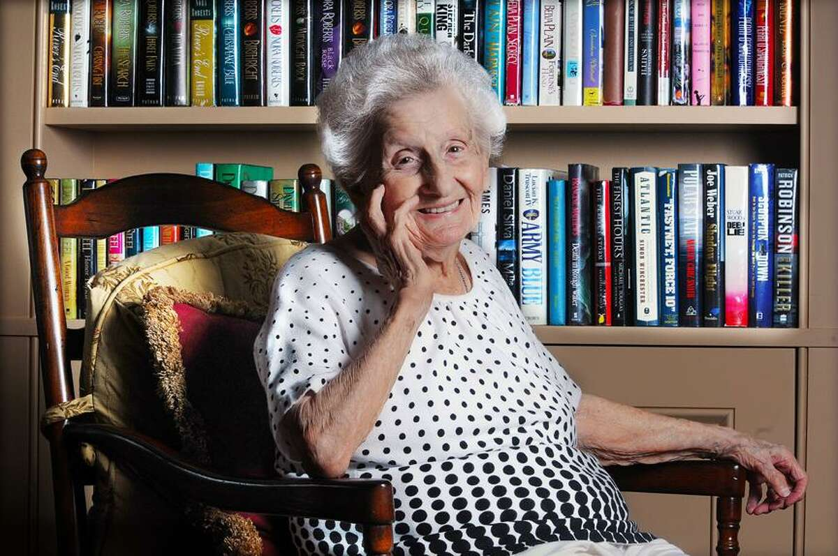 Catherine Avalone/The Middletown Press Mae Gaudio, an avid reader born in 1913 recently celebrated her 100th birthday on April 24 at The Saybrook at Haddam.