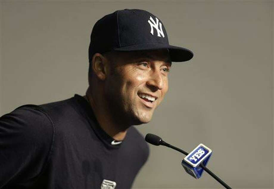 New York Yankees' Derek Jeter smiles while taking questions from reporters at a news conference after the Yankees' baseball game against the Kansas City Royals at Yankee Stadium on Thursday, July 11, 2013 in New York. The Yankees beat the Royals 8-4. Jeter left the game early with a tight right quadriceps. (AP Photo/Seth Wenig) Photo: AP / AP