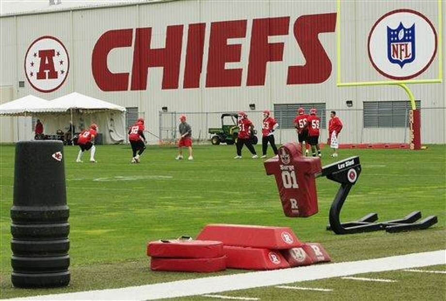 In this Wednesday, May 19, 2010 photo, Kansas City Chiefs football players work out during an NFL football mini camp at the team's practice facility in Kansas City, Mo. Police say a 25-year-old Kansas City Chiefs player was involved in two shootings Saturday, Dec. 1, 2012, one of which occurred in the parking lot near Arrowhead Stadium.  (AP Photo/Orlin Wagner) Photo: AP / AP