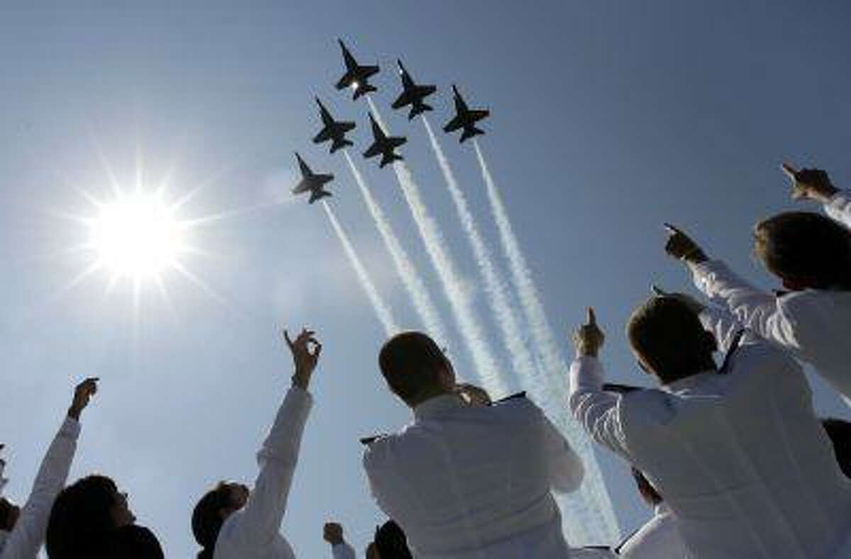 In a Tuesday, May 29, 2012 file photo, a formation of U.S. Navy Blue Angel fighter jets perform a flyover above graduating Midshipmen during the United States Naval Academy graduation and commissioning ceremonies in Annapolis, Md. (AP Photo/Patrick Semansky, File)