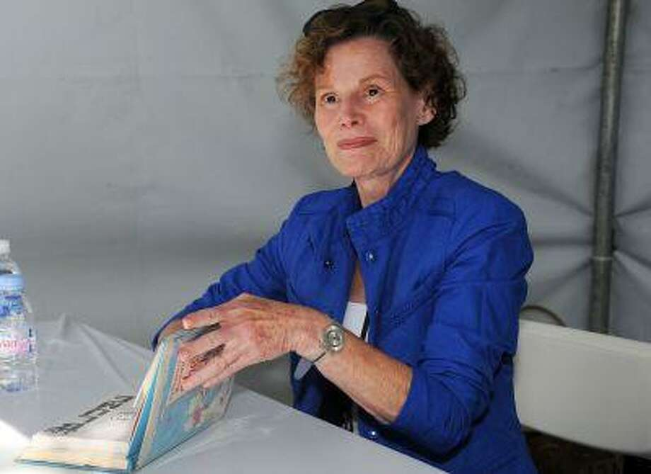 "FILE - This April 21, 2012 file photo shows author Judy Blume attending the LA Times Festival of Books at the USC Campus in Los Angeles. Blume says she was diagnosed with breast cancer over the summer but is ""feeling stronger every day"" after surgery. The 74-year-old Blume wrote on her blog Wednesday, Aug. 5, that she learned in June that she had cancer and underwent a mastectomy and reconstruction in late July. She writes that she now walks a couple of miles each morning and dines out at night. Blume hopes to begin writing again soon.(AP Photo/Katy Winn, file) Photo: ASSOCIATED PRESS / A2012"