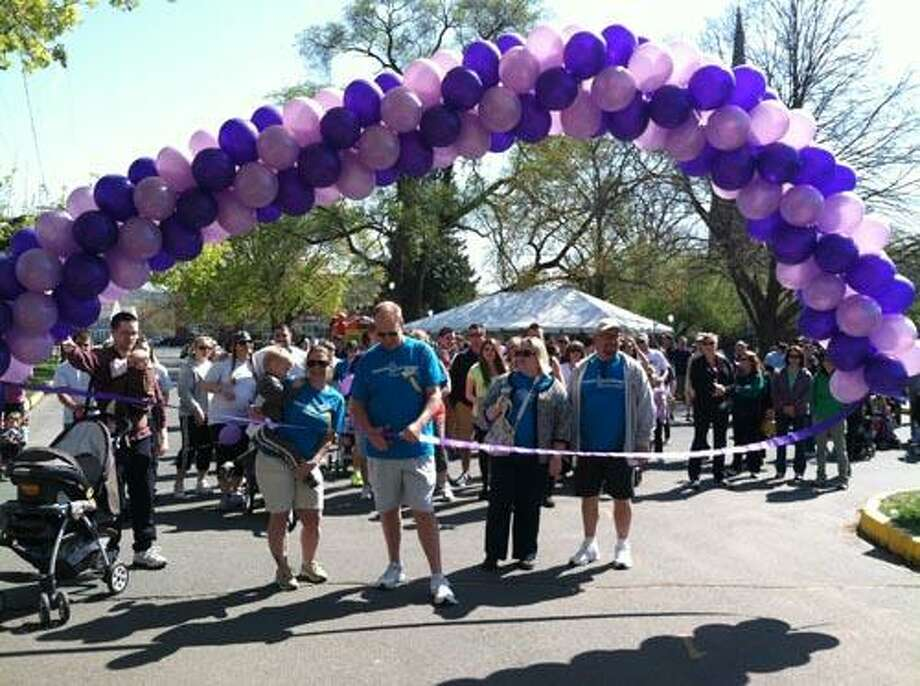 The Poole family of Middletown, the event's Ambassador family, cut the ribbon to officially kick off Middletown March for Babies on Saturday, April 27.