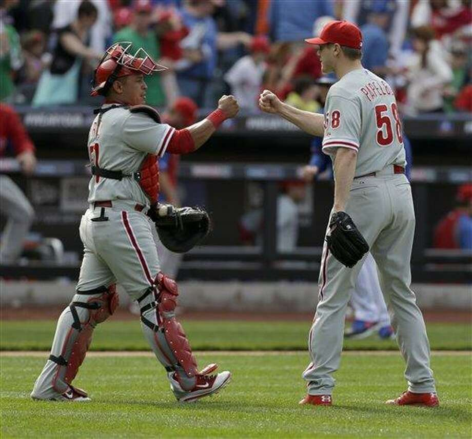 Philadelphia Phillies' Carlos Ruiz, left, and Jonathan Papelbon celebrate after the baseball game against the New York Mets at Citi Field Sunday, April 28, 2013 in New York. The Phillies beat the Mets 5-1. (AP Photo/Seth Wenig) Photo: AP / AP
