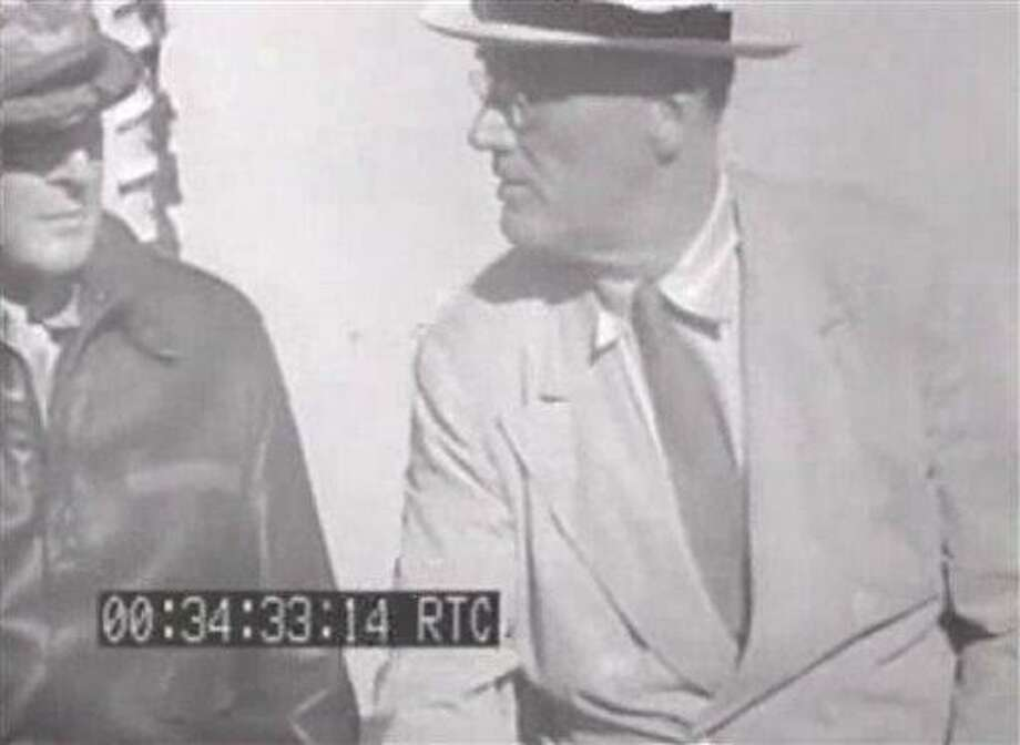 This image from an eight-second film clip provided by the National Archives shows President Franklin Delano Roosevelt, right, aboard the U.S.S. Baltimore in Pearl Harbor in July 1944, depicting a secret not revealed to the public until after his death. Person at left is unidentified. (AP Photo/National Archives) Photo: AP / National Archives