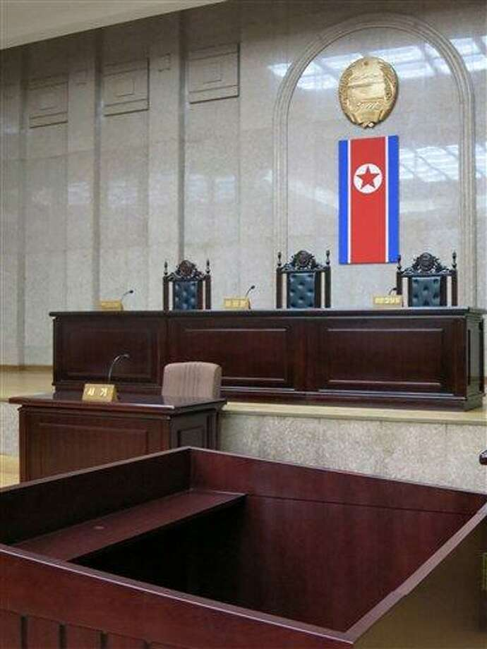 In this March 20, 2013 photo, a North Korean flag hangs inside the interior of Pyongyang's Supreme Court.  North Korea says it will soon deliver a verdict in the case of detained American Kenneth Bae it accuses of trying to overthrow the government, further complicating already fraught relations between Pyongyang and Washington. The announcement about Bae comes in the middle of a lull after weeks of war threats and other provocative acts by North Korea against the U.S. and South Korea.  Bae, identified in North Korean state media by his Korean name, Pae Jun Ho, is a tour operator of Korean descent who was arrested after arriving with a tour on Nov. 3 in Rason, a special economic zone bordering China and Russia.  (AP Photo) Photo: AP / AP