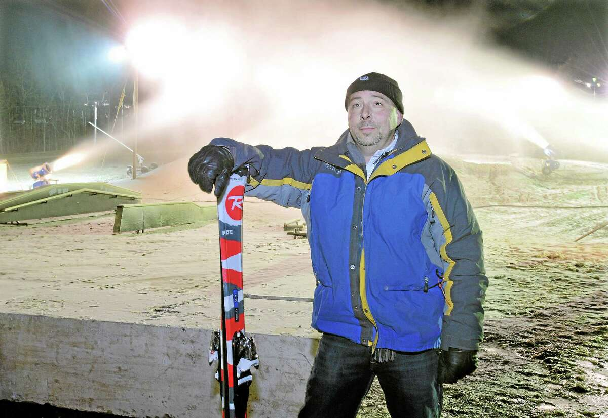 Sean Hayes, owner of Powder Ridge Mountain Resort in Middlefield with the snow machines pumping out snow Friday night, opening day. Catherine Avalone - The Middletown Press