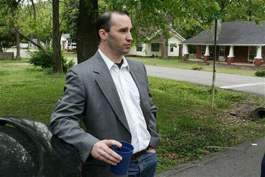 FILE - In this Tuesday April 23, 2013 file photo, Everett Dutschke stands in the street near his home in Tupelo, Miss., and waits for the FBI to arrive and search his home in connection with the sending of poisoned letters to President Barack Obama and others. FBI spokeswoman Deborah Madden says Dutschke, 41, was arrested Saturday, April 27, 2013, at his Tupelo home in connection with the letters, which allegedly contained ricin. They were sent last week to Obama, Sen. Roger Wicker of Mississippi and earlier to 80-year-old Mississippi Judge Sadie Holland. (AP Photo/Northeast Mississippi Daily Journal, Thomas Wells, File) MANDATORY CREDIT Photo: AP / The Northeast Mississippi Daily Journal