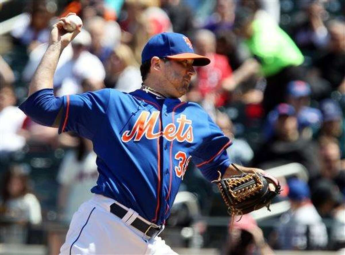 New York Mets starting pitcher Shaun Marcum throws against the Philadelphia Phillies in the first inning of a baseball game in New York on Saturday, April 27, 2013. (AP Photo/Peter Morgan)