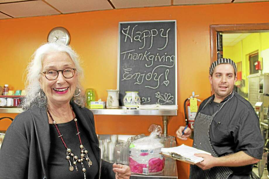 Assistant Director Lydia Brewster (left) and chef Jeremiah Rufini prepare St. Vincent de Paul's annual Thanksgiving meal. Photo: Bob Walsh - Special To The Press