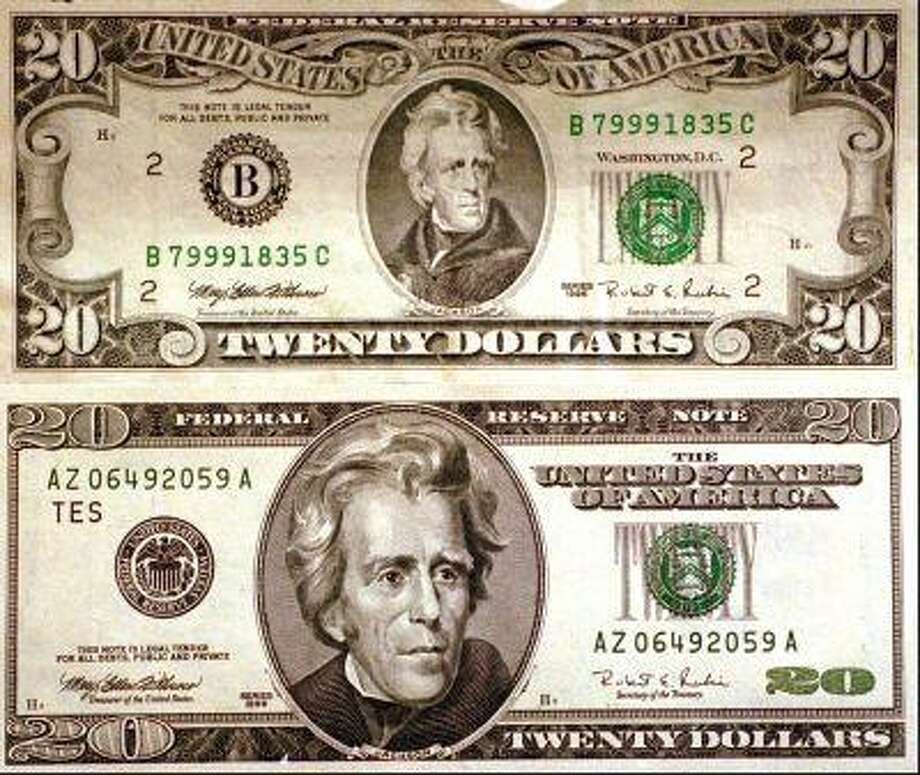 A 1998 United States $20 dollar bill, bottom, is seen with its predecessor at the Federal Reserve Bank of Philadelphia. (AP Photo/File, Dan Loh) Photo: ASSOCIATED PRESS / AP1998