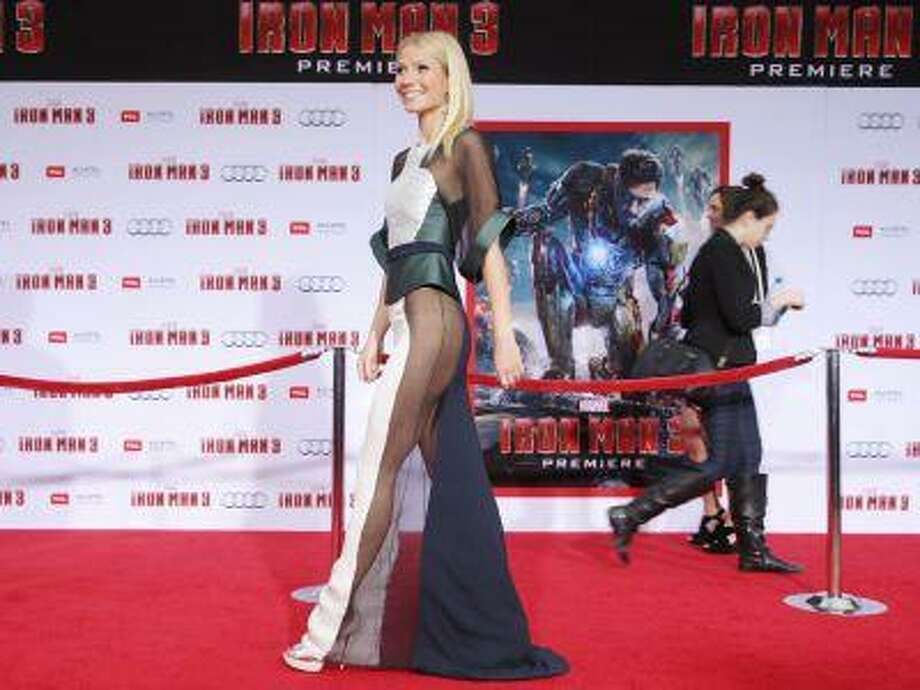"This April 24, 2013 file photo shows actress Gwyneth Paltrow wearing a sheer dress at the world premiere of ""Iron Man 3"" held at the El Capitan Theatre in Los Angeles. Paltrow says she's thrilled to be picked by People magazine as ""World's Most Beautiful Woman"" for 2013 but it's ""obviously not true."" Paltrow questioned her own selection as she walked the red carpet at the Hollywood premiere of ""Iron Man 3"" Wednesday night. ""It's funny, these things, because it's like obviously not true. But it's very sweet to be named that,"" Paltrow told The Associated Press. The 40-year-old actress stars as Pepper Potts, Tony Stark's love interest and assistant-turned-business partner in the ""Iron Man"" trilogy. (Photo by Eric Carbonneau/Invision/AP) Photo: Eric Charbonneau/Invision/AP / Invision"