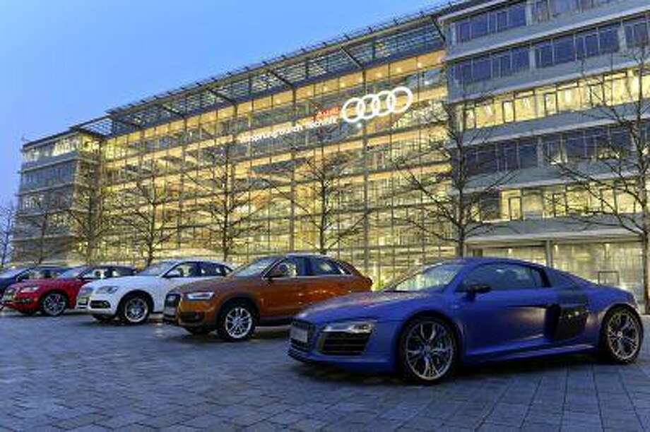 TRADE ASSESS: Audis lined up at the company's plant in Ingolstadt, Germany. Audi hopes that negotiations on a new trade pact will lift U.S. restrictions on its futuristic headlights. Illustrates TRADE-ASSESS (category f) by Brian Wingfield and Rebecca Christie (c) 2013, Bloomberg News. Moved: Monday, July 8, 2013 (MUST CREDIT: Bloomberg News photo by Guenter Schiffmann).