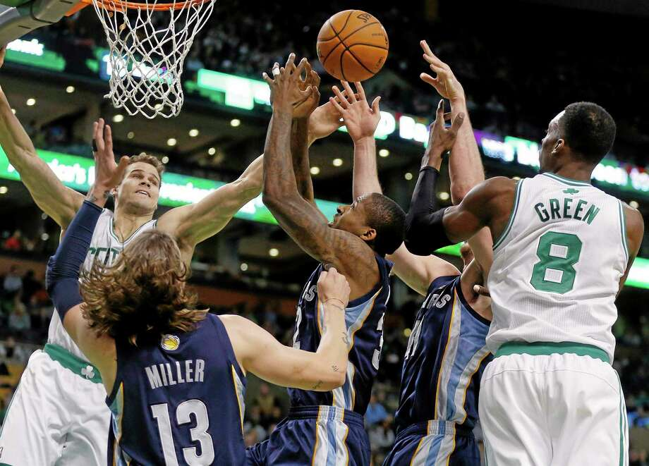 The Celtics' Kris Humphries, left, and Jeff Green (8) battle for a rebound with the Memphis Grizzlies' Mike Miller (13), Ed Davis, center, and Kosta Koufos, second from right, in the first quarter of Wednesday's game in Boston. Photo: Michael Dwyer — The Associated Press  / AP