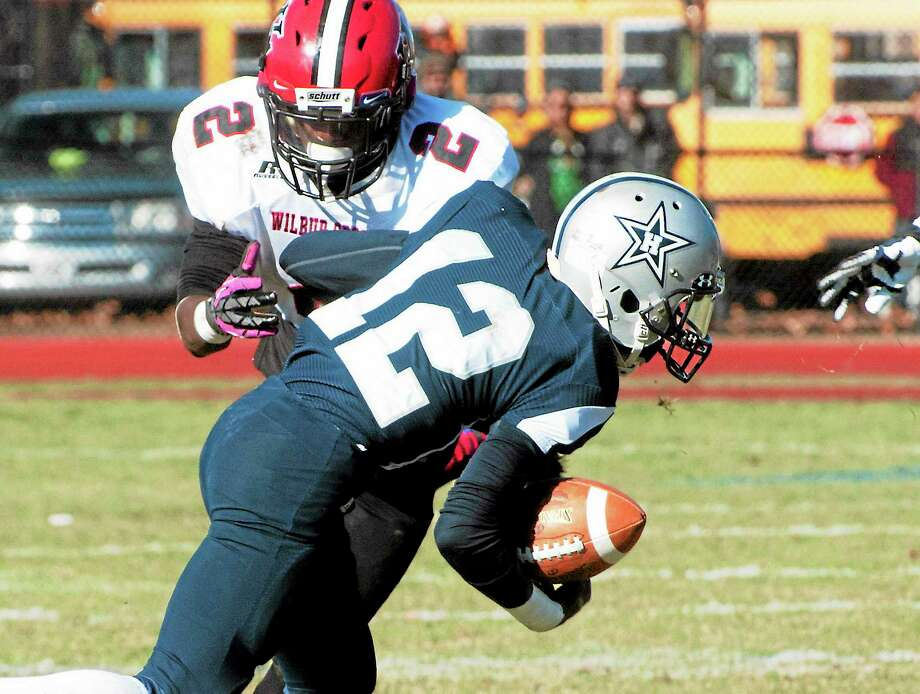 vmWilliams - New Haven RegisterHillhouse's  Ja Von  Taylor runs the ball in the 2013 Elm City Bowl at Wilbur Cross athletic facility Thanksgiving November 28. Hillhouse defeated Wilbur Cross 21-19. Photo: Journal Register Co.