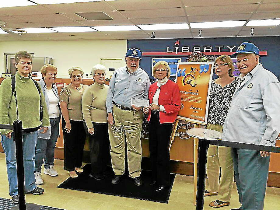 Submitted photoFrom left, Kate O'Boyle and Jeanne Necle, Rotary; Sue Prueher, Liberty Bank; Patti Veselak and Roger Stube, Rotary; Nancy Smith, Liberty Bank; and Deb Denette, and Charles Hnilicka, Rotary, during a check presentation for a Thanksgiving drive. Photo: Journal Register Co.