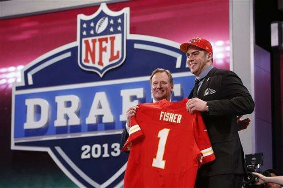 Eric Fisher, from Central Michigan, stands with NFL Commissioner Roger Goodell after being selected first overall by the Kansas City Chiefs in the first round of the NFL football draft, Thursday, April 25, 2013, at Radio City Music Hall in New York. (AP Photo/Jason DeCrow) Photo: ASSOCIATED PRESS / AP2013