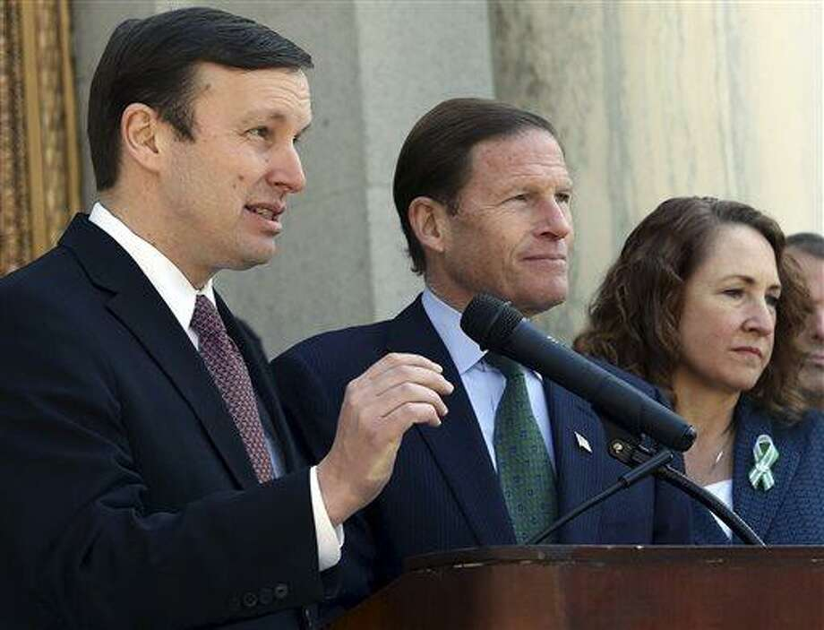 Sen. Chris Murphy, D-Conn., left, speaks while Sen. Richard Blumenthal, D-Conn., center, and U.S. Rep. Elizabeth Esty, D-5, listen on the steps of Hartford Conn., City Hall Friday April 5, 2013, as they joined others to urge passage of federal legislation to curb gun violence. (AP Photo/Journal Inquirer, Jared Ramsdell) Photo: AP / Journal Inquirer