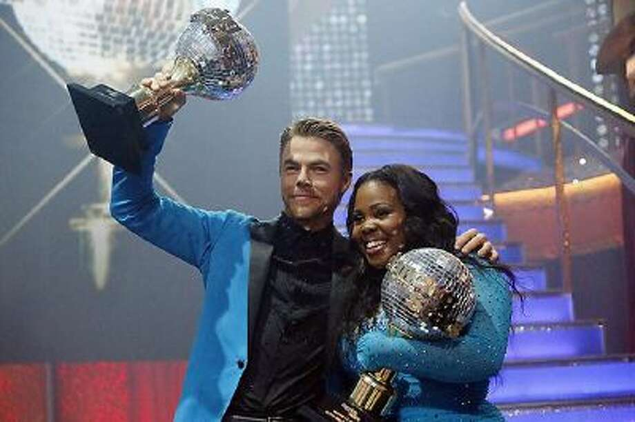 Derek Hough and Amber Riley after winning during the 'Dancing with the Stars' finale on Tuesday, Nov. 26, 2013. / © 2013 American Broadcasting Companies, Inc. All rights reserved.