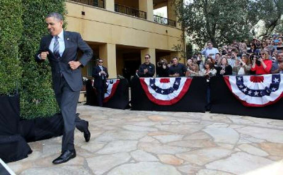 President Obama runs to a speech outside Los Angeles on Tuesday. The same day, his administration proposed regulations for nonprofits that spend money on political objectives. Photo: Getty Images / 2013 Getty Images