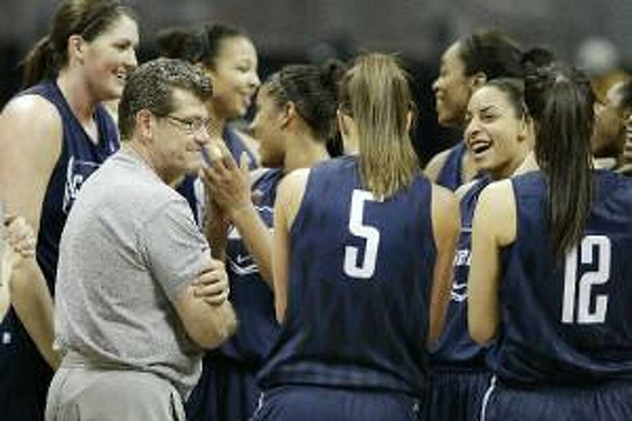 ASSOCIATED PRESS Connecticut head coach Geno Auriemma talks with his team during practice at the NCAA Women's Final Four in Denver Saturday.