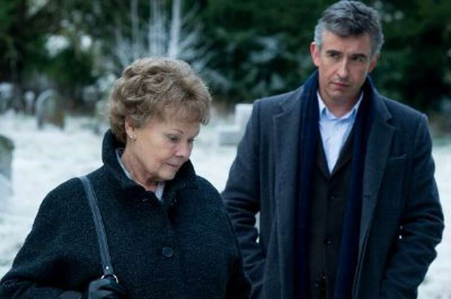 "Philomena (Judi Dench) travels to the United States in search of her son with journalist Martin Sixsmith (Steve Coogan) in ""Philomena."""