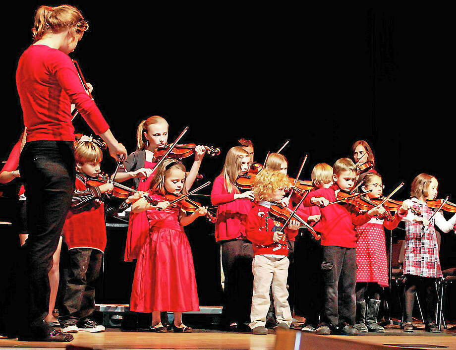 Submitted photo - Community Music School The Community Music School is hosting its annual holiday concert in December. Above, the chool's Suzuki Violin Ensemble perform at the 2012 Holiday Concert. Photo: Journal Register Co.
