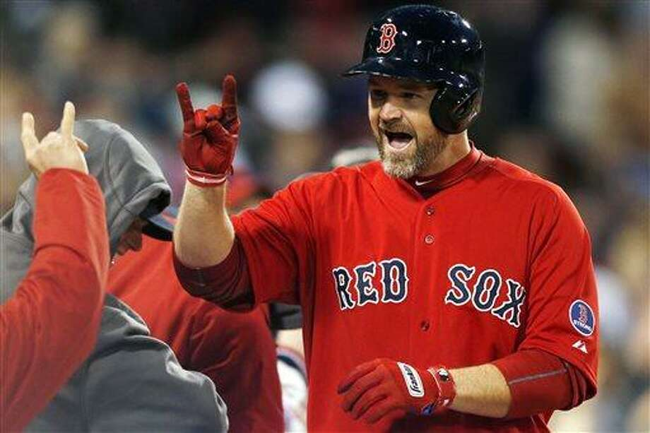 Boston Red Sox's David Ross celebrates his solo home in the second inning of a baseball game against the Houston Astros in Boston, Friday, April 26, 2013. (AP Photo/Michael Dwyer) Photo: ASSOCIATED PRESS / AP2013