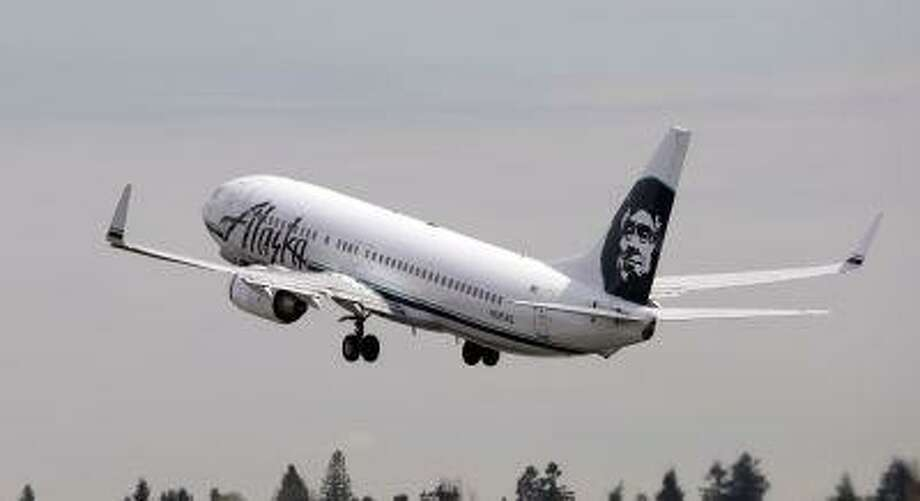 An Alaska Airline jet takes off at Seattle-Tacoma International Airport Tuesday, April 23, 2013, in Seattle. (AP Photo/Elaine Thompson) Photo: AP / AP