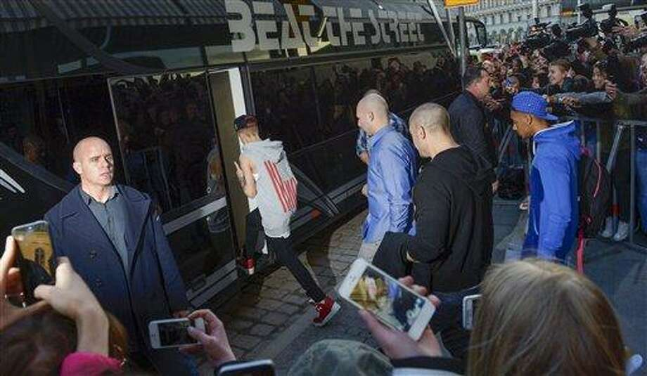 This Tuesday April 23, 2013, photo from files shows singer Justin Bieber boarding his tour bus outside Grand Hotel where Bieber was staying during his concerts in Stockholm, Sweden. Swedish police said on Thursday they found drugs on Bieber's tour bus in Stockholm, but had no suspects and were unlikely to pursue the case further. (AP Photo/Scanpix Sweden, Leo Sellen, File)   SWEDEN OUT Photo: AP / Scanpix Sweden