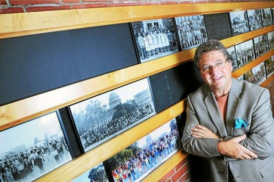 Catherine Avalone - The Middletown Press East Hampton Assistant Superintendent of Schools Kevin Reich is seeking additional class photos that hang in the high school from the past 70 years. / TheMiddletownPress