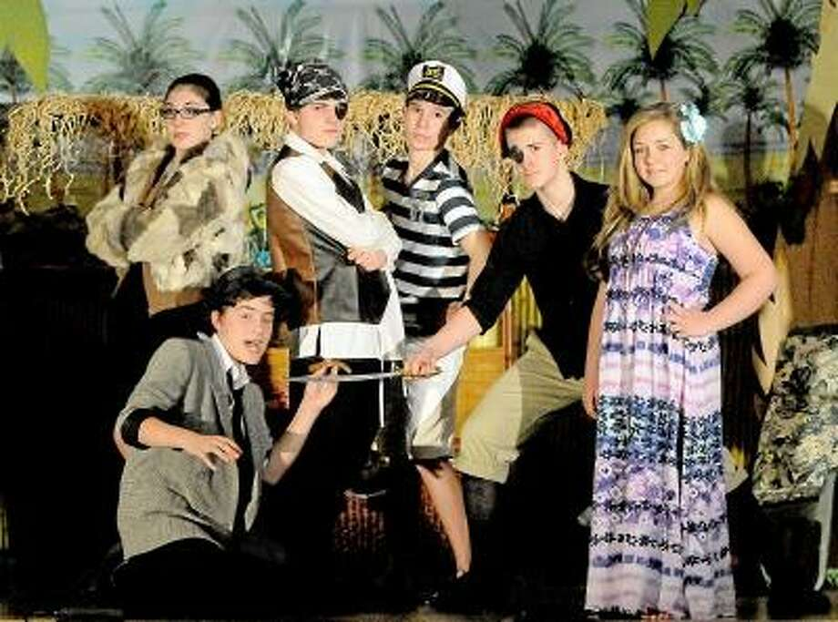 """Catherine Avalone/The Middletown Press   St. Mary School production of """"Kokonut Kapers"""" cast members from left to right Taylor Muraca as mob lady Doris Hoyt, Spencer Appell as the shady character Chic Sutherland, Lorenzo Genovese as Swampy, the 300-year old pirate, Kyle Rodrigues as Tom Scrimshaw, Vincent Stifano as Capt'n Kidd and Gwenyth Pytel as Coridilia, the island owner. The 38 member cast of students from the third to the the eighth grade turn the 1930 stage into Kokonut Island. The show is Friday and Saturday at 7 p.m. / TheMiddletownPress"""