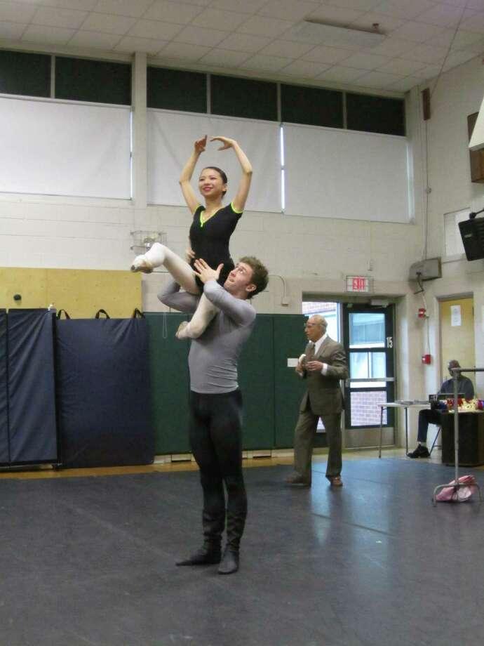 Eric Carnes with Miku Kawamura demonstrating the art of the pas de deux (partnering) at Bielefield School.