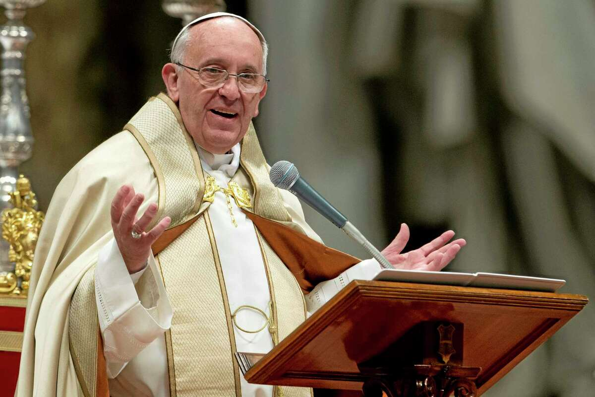 Pope Francis celebrates a Mass in St. Peter's Basilica, at the Vatican, Saturday, Nov. 23, 2013. (AP Photo/Andrew Medichini)