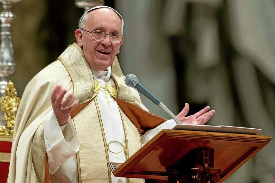 Pope Francis celebrates a Mass in St. Peter's Basilica, at the Vatican, Saturday, Nov. 23, 2013. (AP Photo/Andrew Medichini) Photo: AP / AP