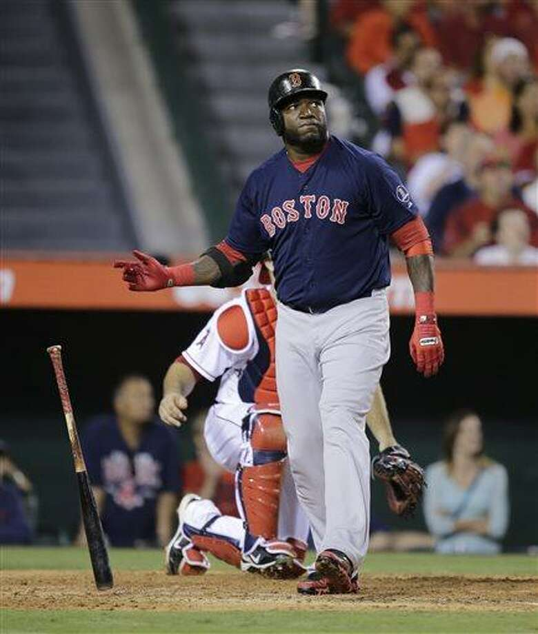 Boston Red Sox's David Ortiz watches the flight of his two-run home run during the eighth inning of a baseball game against the Los Angeles Angels in Anaheim, Calif., Friday, July 5, 2013. (AP Photo/Jae C. Hong) Photo: AP / AP