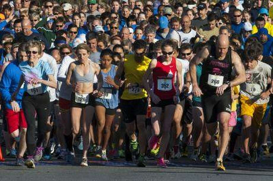 Runners who dread slowing down can get faster even as they get older. Dee Nelson, in blue T-shirt at left, competes in a 5K race in Potomac, Md., this month. (Washington Post/Katherine Frey) Photo: The Washington Post / WASHINGTON POST