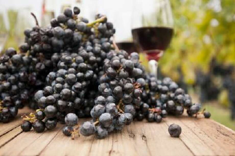 Grapes and glasses of wine on table outdoors. Photo: Getty Images/Blend Images / Blend Images