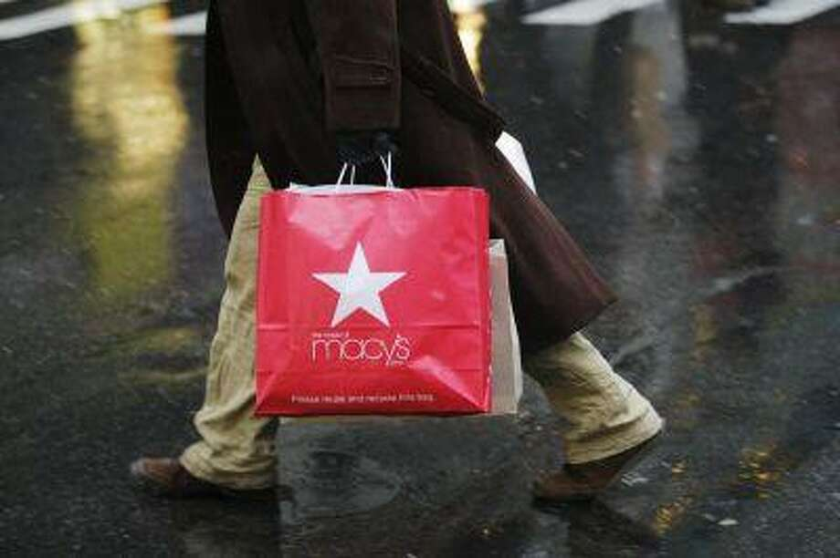 A shopper walks on a street in New York, December 26, 2012. / X01440