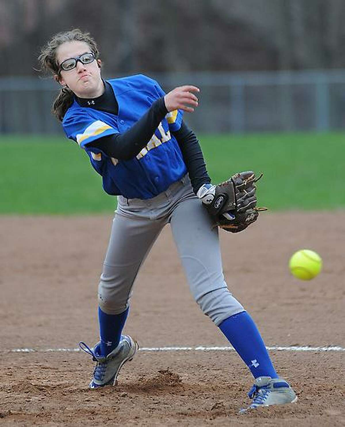 Catherine Avalone/The Middletown Press Vinal Tech freshman pitcher Hannah Bibisi on the mound against Whitney Tech Tuesday afternoon in Middletown. Vinal Tech defeated Whitney Tech 26-2.